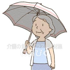日傘をさす高齢女性のイラスト
