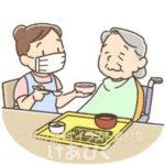 マスクをして食事介助する介護士のイラスト